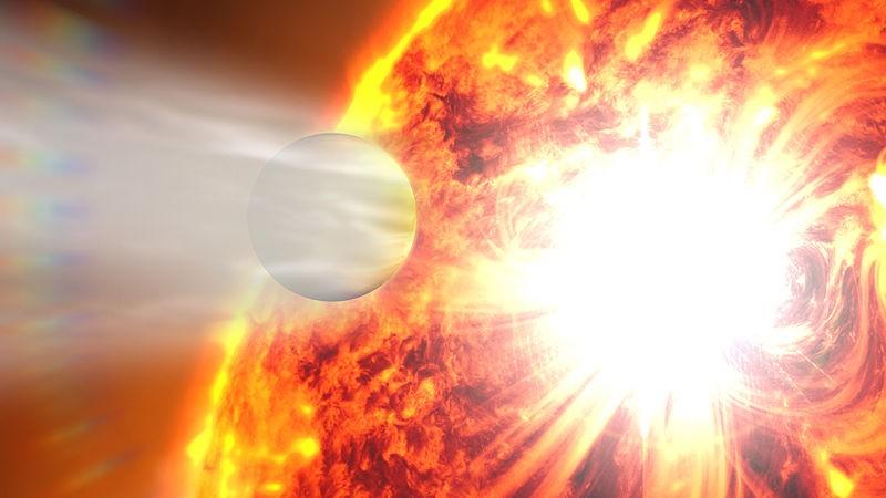 Система планеты HD 189733 во время звёздной вспышки в представлении художника. Автор: NASA's Goddard Space Flight Center [Public domain] ( http://www.nasa.gov/images/content/663562main_Evaporating_Exoplanet_Beauty_Small.jpg )