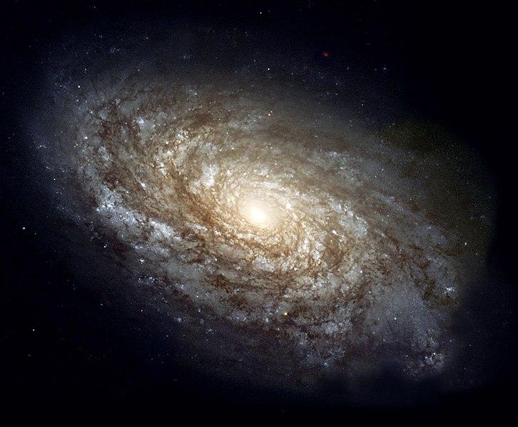 NGC 4414, спиральная галактика из созвездия Волосы Вероники, диаметром около 17 килопарсек, расположенная на расстоянии около 20 мегапарсек от Земли